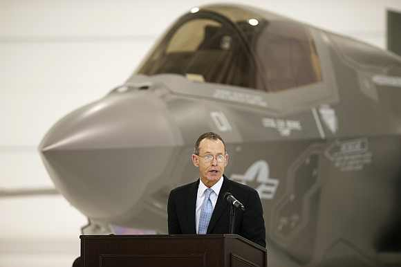 Chairman and CEO of Lockheed Martin, Robert Stevens speaks in front of a US Marine F-35B Joint Strike Fighter Jet during the roll-out ceremony at Eglin Air Force Base in Florida
