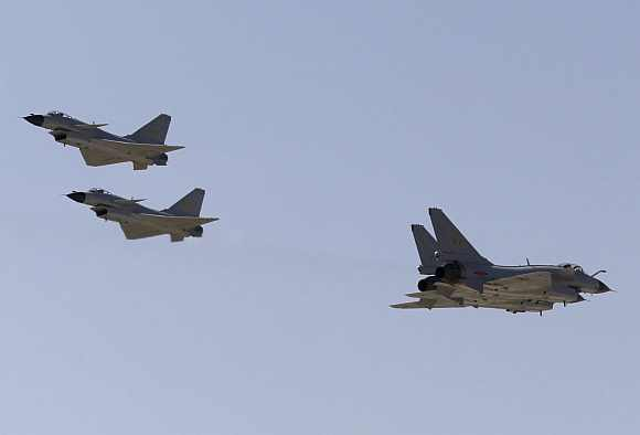 J-10 fighter jets of China Air Force fly at Yangcun Air Force base on the outskirts of Tianjin municipality