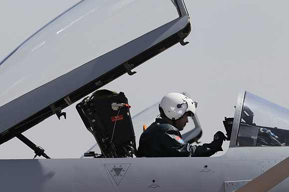 A pilot sits in the cockpit of a J-10 fighter jet