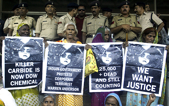 Victims of Bhopal gas tragedy hold posters during a demonstration
