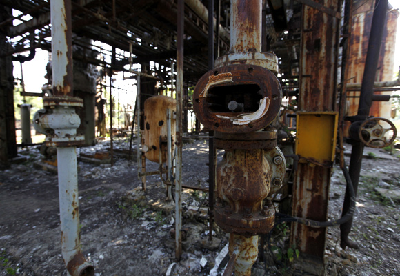 Broken valves are left in the former laboratory of a Union Carbide Corp, now part of Dow Chemical Co, pesticide plant in Bhopal