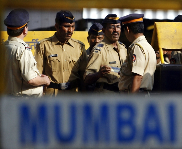 Policemen stand guard outside a jail in Mumbai, where 26/11 terrorist Ajmal Kasab is lodged