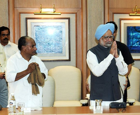 File photo shows Defence Minister A K Antony with Prime Minister Manmohan Singh at a Cabinet meet