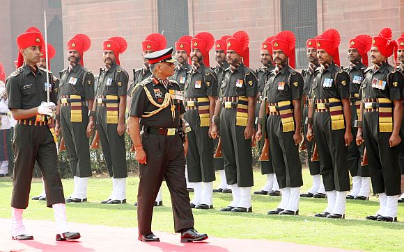 File photo shows General Singh inspecting a guard of honour