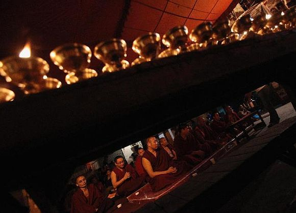 Tibetan monks in Majnu Ka Tila at a prayer meeting for Jamphel Yeshi, who set himself on fire during a protest against then Chinese president Hu Jintao's visit in March 2012. Photograph: Adnan Abidi/Reuters