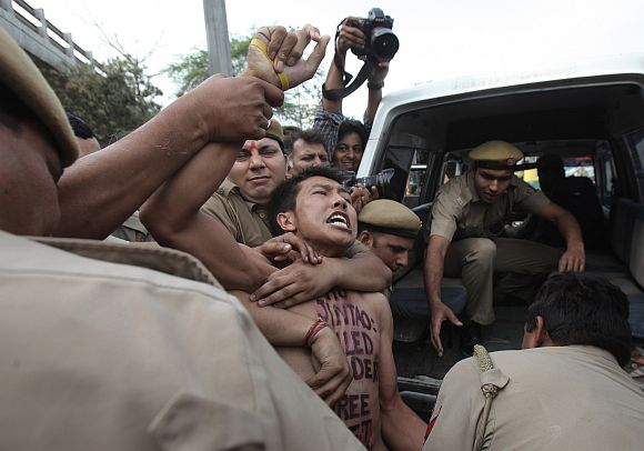 A young Tibetan is detained by Delhi police during a protest outside the hotel where then Chinese president Hu Jintao was staying in March 2012. Photograph: Adnan Abidi/Reuters
