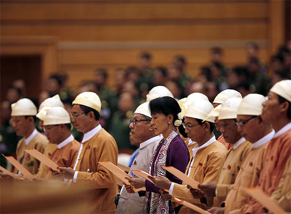 Myanmar pro-democracy leader Aung San Suu Kyi and members of parliament from the National League for Democracy take their oaths in the lower house of parliament in Naypyitaw