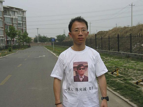 One of China's most prominent dissidents, Hu Jia, wears a shirt in support of blind Chinese lawyer Chen Guangcheng, in this undated handout