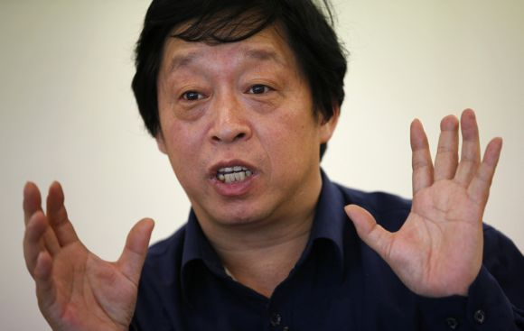 Liu Anjun gestures during an interview in Beijing