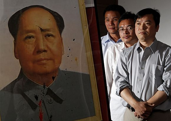 On June 2, 2009, three Chinese dissidents, from left to right, Yu Zhijian, Yu Dongyue and Lu Decheng pose beside a photograph of the defaced Chairman Mao portrait, which they had pelted with dye-filled eggs during the 1989 Tiananmen Square democracy movement