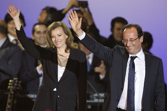 France's newly-elected President Francois Hollande and his companion Valerie Trierweiler celebrate on stage during a victory rally at Place de la Bastille in Paris