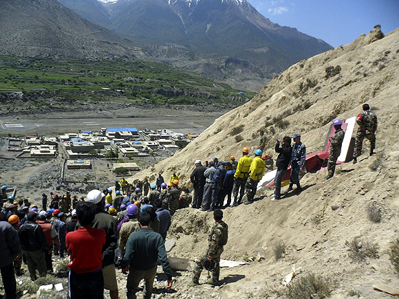 Wreckage of the Dornier aircraft is pictured at the crash site at Jomsom