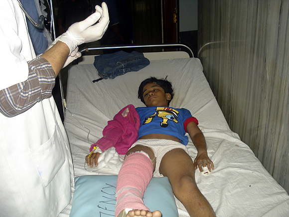 An Indian girl who survived the plane crash receives treatment at a hospital in Pokhara