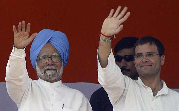 Prime Minister Manmohan Singh and Rahul Gandhi wave to supporters
