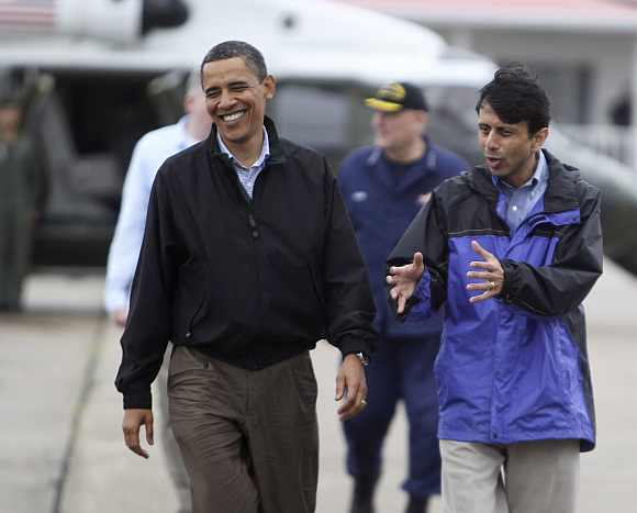 US President Obama interacts with Louisiana Governor Jindal in New Orleans