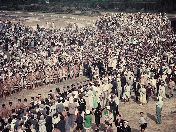 Queen Elizabeth II and Prince Philip walk through the crowd at Arawa Park, Rotorua, during her Commonwealth visit to New Zealand. She was met by around 20,000 Maoris from all over the country. Photo taken in January 1954