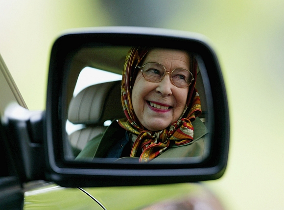 Queen Elizabeth II is seen reflected in the wing mirror of her Land Rover as she follows The Duke of Edinburgh as he competes in the Driving Grand Prix Competition B -- the marathon event during the Royal Windsor Horse Show at Home Park, Windsor Castle in Windsor, England. Photo taken on 14 May, 2005