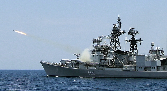 An Indian ship fires a missile during a joint Indo-Lanka naval exercise at Trincomalee navy base in Trincomalee
