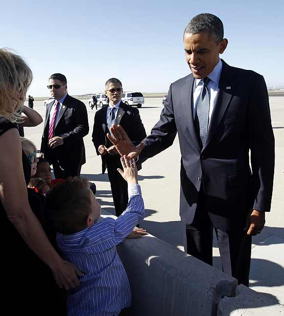 Obama gives a boy a high five upon his arrival in Colorado Springs, Colorado on May 23