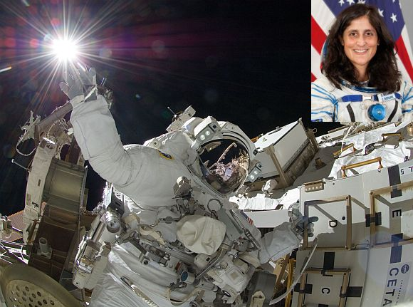 NASA astronaut Sunita Williams, Expedition 32 flight engineer, appears to touch the bright sun