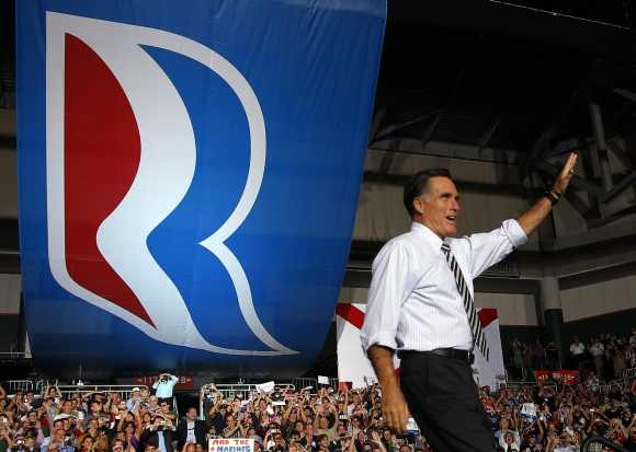 Republican presidential nominee Mitt Romney takes the stage at a campaign rally in Coral Gables, Florida