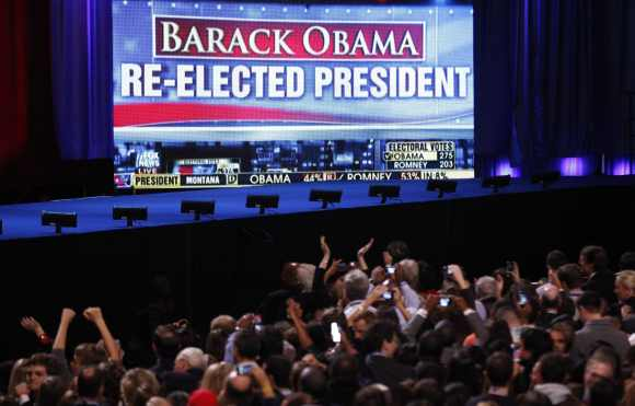 Supporters of US President Barack Obama cheer the news of the President's re-election