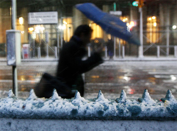 Snow rests on the entrance to the Wall St. subway station in New York
