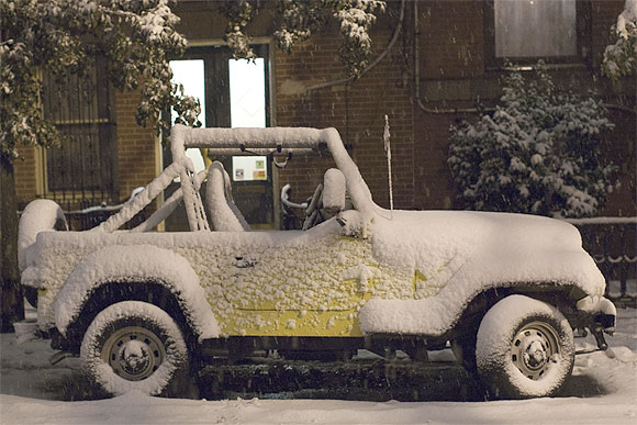 A car is seen covered in snow during the nor'easter, also known as a northeaster storm, in Jersey City, New Jersey