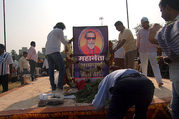 In Mumbai's Shivaji Park, Shiv Sena supporters pay their last respects at the site where Bal Thackeray was cremated on November 19, 2012.
