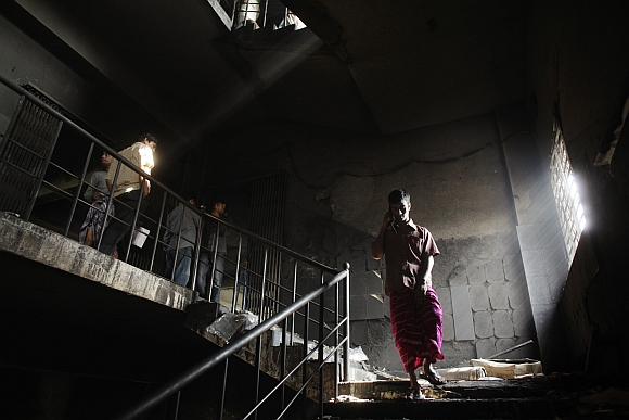 Workers visit a burnt garment factory after the devastating fire