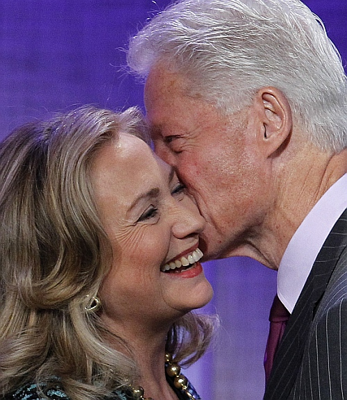 Former US President Bill Clinton kisses his wife, US Secretary of State Hillary Clinton, as he introduces her before her speech at the Clinton Global Initiative 2012 in New York