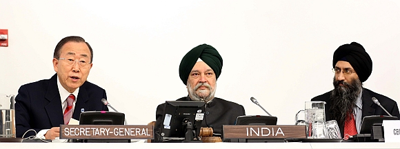 United Nations Secretary General Ban Ki Moon speaks, as Indian Ambassador to the United States Hardeep Singh Puri and Datawind Chief Executive Officer Suneet Singh Tuli look on