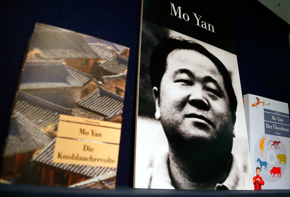 Books of Chinese writer Mo Yan are on display during a book fair