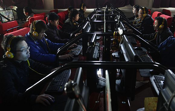 People use computers at an Internet cafe in Changzhi, China