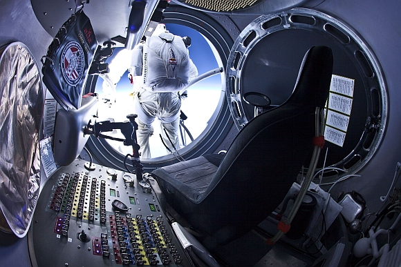 Baumgartner steps out from the capsule