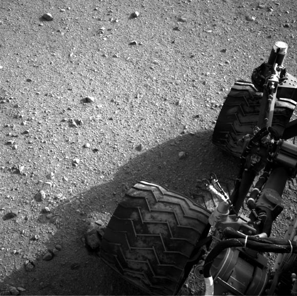 Soil clinging to the right middle and rear wheels of NASA's Mars rover Curiosity can be seen after the rover's third drive on Mars in this handout photo courtesy of NASA.