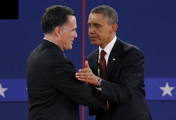 Romney and US President Barack Obama shake hands at the conclusion of the second presidential campaign debate in Hempstead, New York
