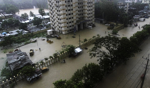 A street is seen submerged by flood water in Chittagong