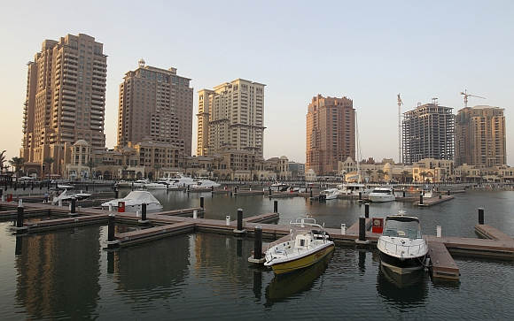Yachts are parked at the Pearl-Qatar harbour in Doha, Qatar