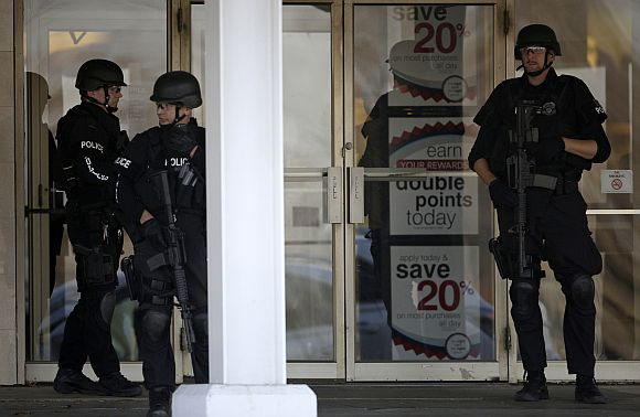 Police stand guard outside the Boston Store, part of the Brookfield Square mall in Brookfield, Wisconsin