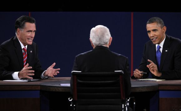 Mitt Romney and US President Obama speak at the same time as moderator Schieffer listens during the final presidential debate in Boca Raton