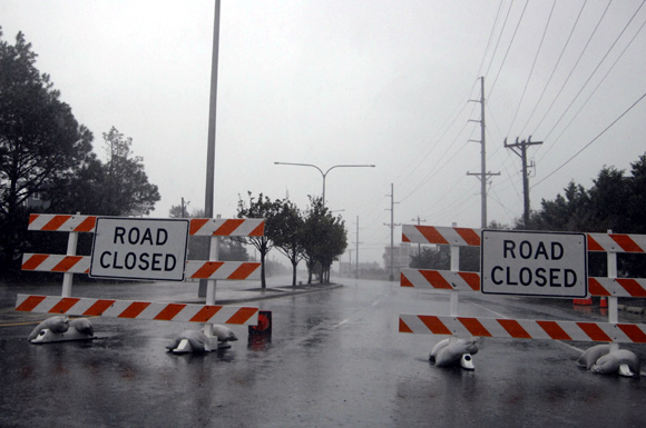 Signs mark road closures as Hurricane Sandy bears down on Dewey Beach, Delaware