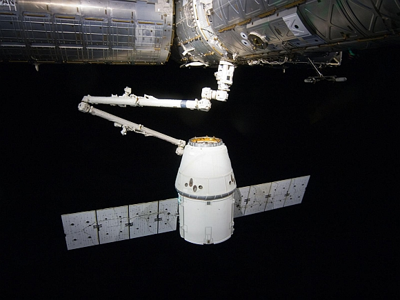 The SpaceX Dragon cargo craft is pictured just prior to being released by the International Space Station's Canadarm2 robotic arm to allow it to head toward a splashdown in the Pacific Ocean