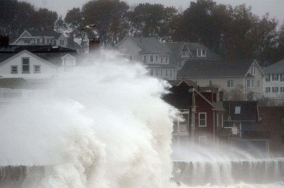 Waves crash over Winthrop Shore Drive as Hurricane Sandy comes up the coast in Winthrop, Massachusetts
