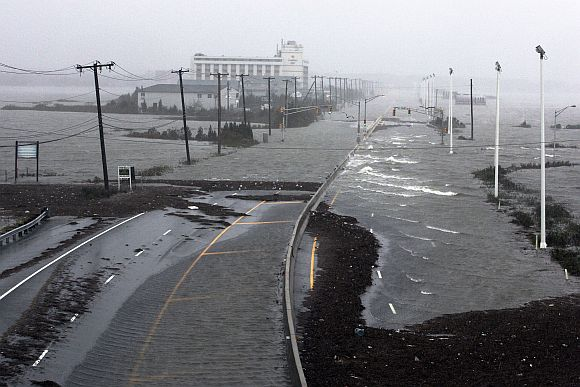 US Route 30, the White Horse Pike, one of three major approaches to Atlantic City, New Jersey, is covered with water from Absecon Bay in this view looking west, during the approach of Hurricane Sandy