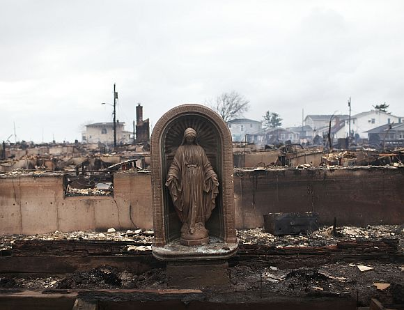 A Virgin Mary is all that remains from a home which was destroyed during Hurricane Sandy in Breezy Point, Queens