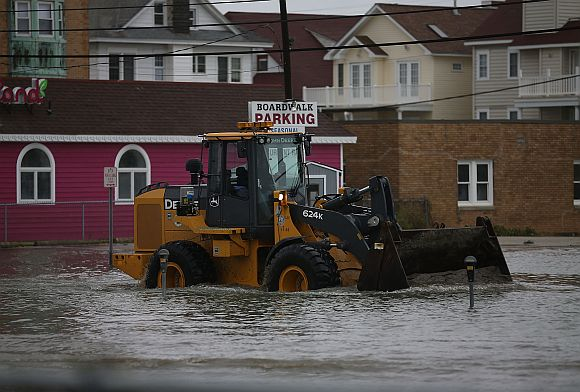 A loader moves sand washed in from Hurricane Sandy in Ocean City, New Jersey
