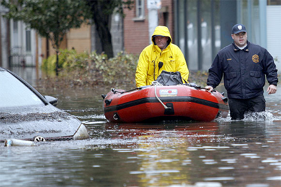 -Rescue workers patrol a flooded street at Hoboken in New Jersey