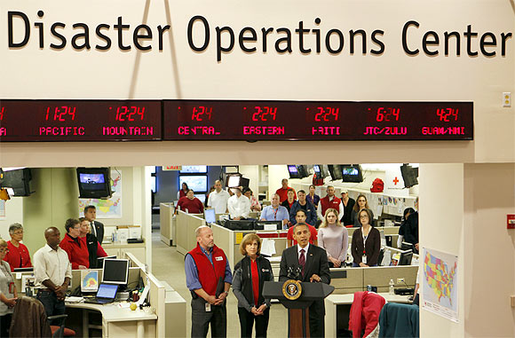 US President Barack Obama talks about the damage done by Hurricane Sandy and rescue efforts while in the Disaster Operations Centre at the National Red Cross Headquarters