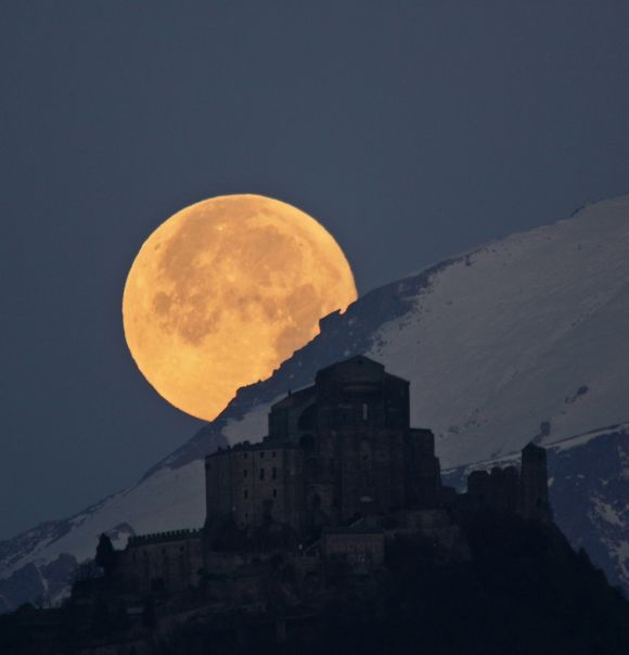 Full Moon setting behind the Alps